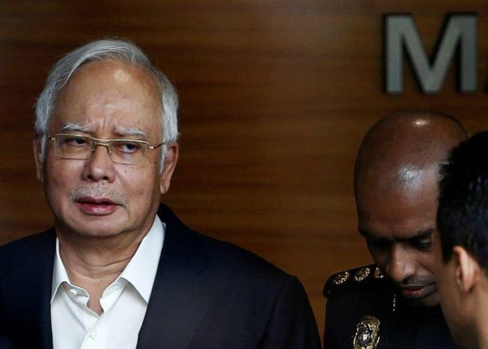 Former Malaysian PM Najib Razak to face 21 money laundering charges - police