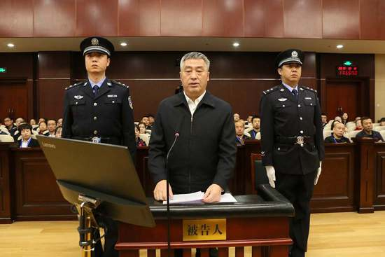 China: Former provincial legislator stands trial for bribery 2