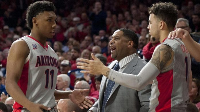 Arizona comes under intense scrutiny with video evidence of former assistant coach accepting $20,000 in bribes