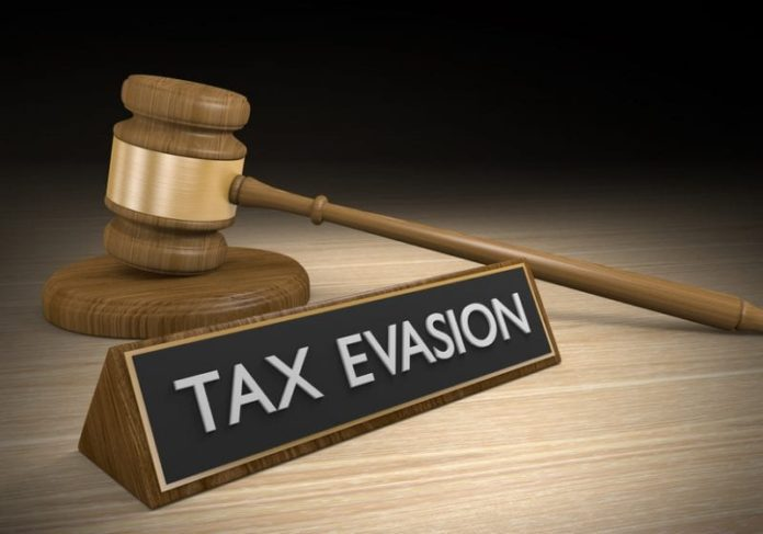 Co-owner of New York apparel firm pleads guilty to tax evasion