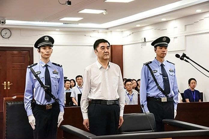 Former head of Xinjiang pleads guilty to bribery