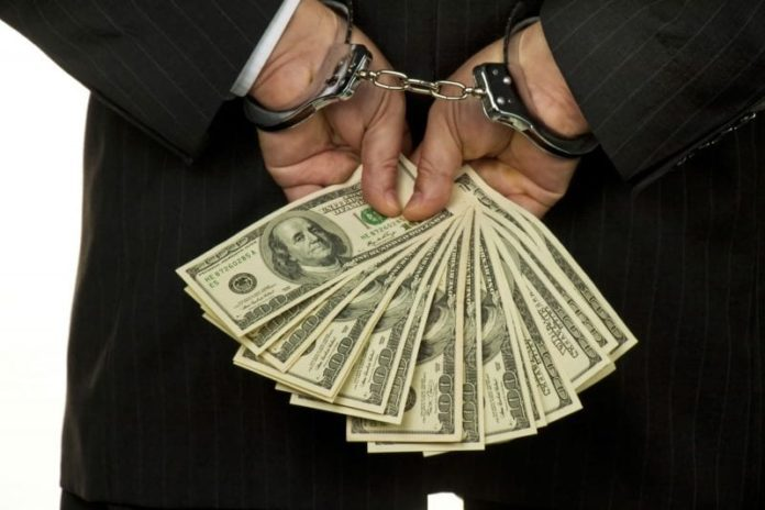 arrested handcuff bribe