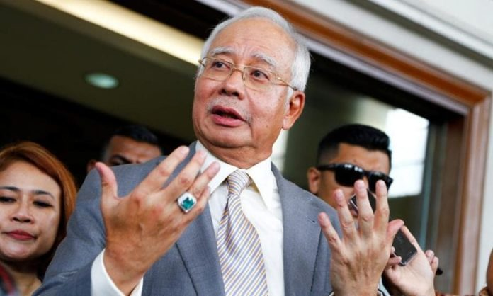 Malaysia's ex-PM Najib Razak money laundering trial on hold to let him join political campaigns