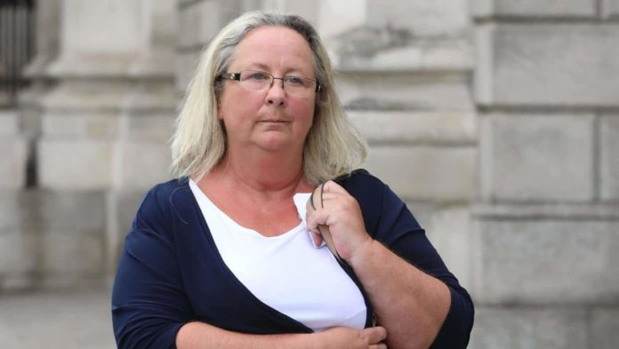 Widow of bereavement charity founder charged with fraudulent trading and money laundering
