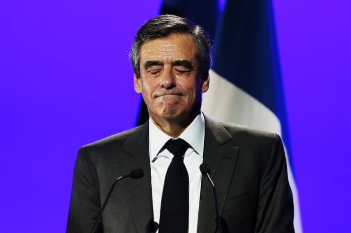 Former French PM François Fillon, wife sentenced to prison for embezzlement