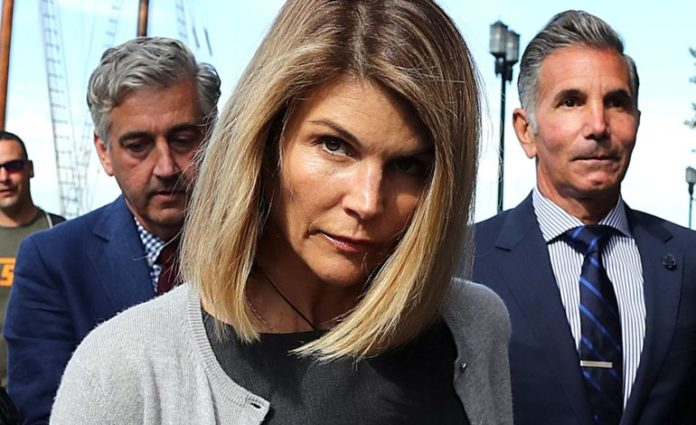 Actress Lori Loughlin gets 2 months in prison over college admission scam