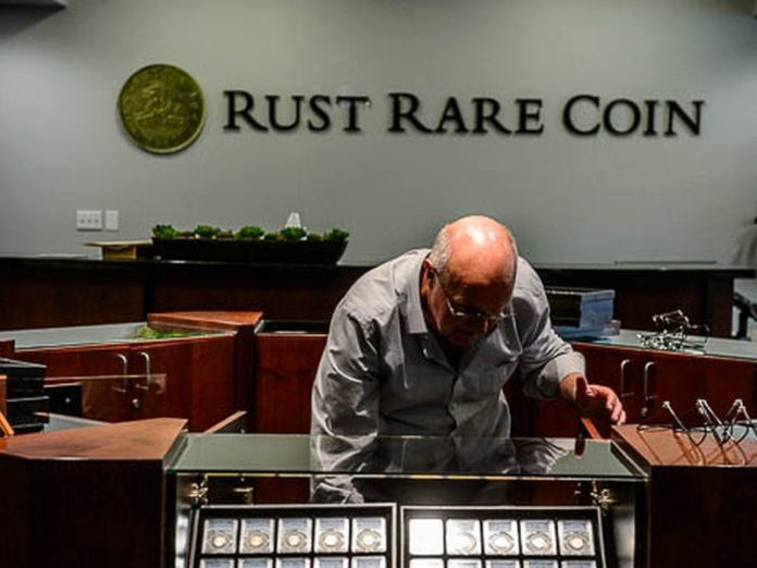 Rust rare-coin dealer's wife agrees plea deal in Ponzi scheme
