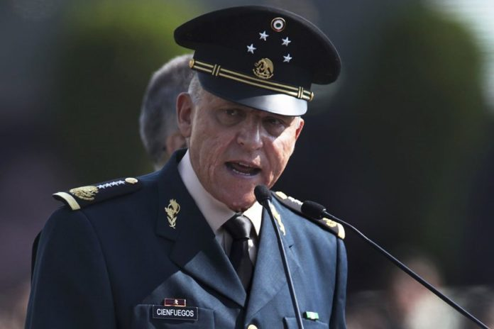 Mexico's ex-army chief arrested in US on charges of drug trafficking, money laundering