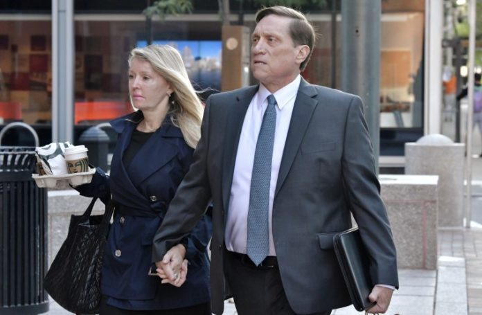 Two wealthy parents convicted in first trial of college admissions cheating scandal